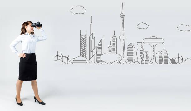 未来的な都市のイラストを見て若い実業家。 ストックフォト