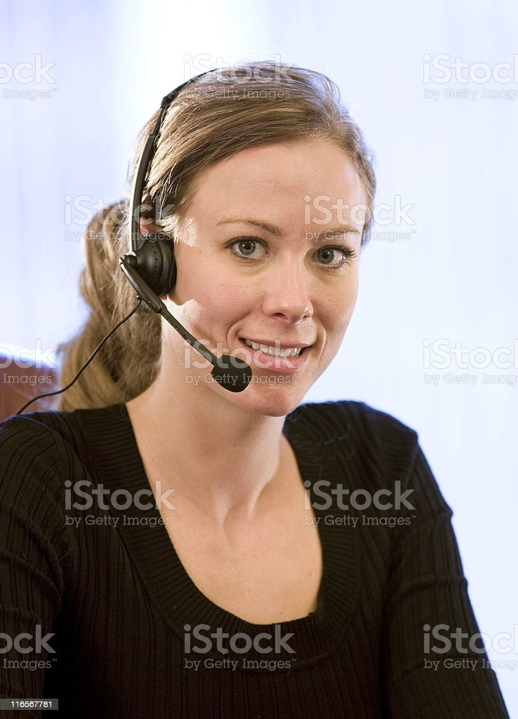 Young Businesswoman Wearing A Headset royalty-free stock photo
