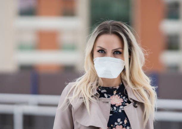 Young businesswoman wearing a protective face mask stock photo