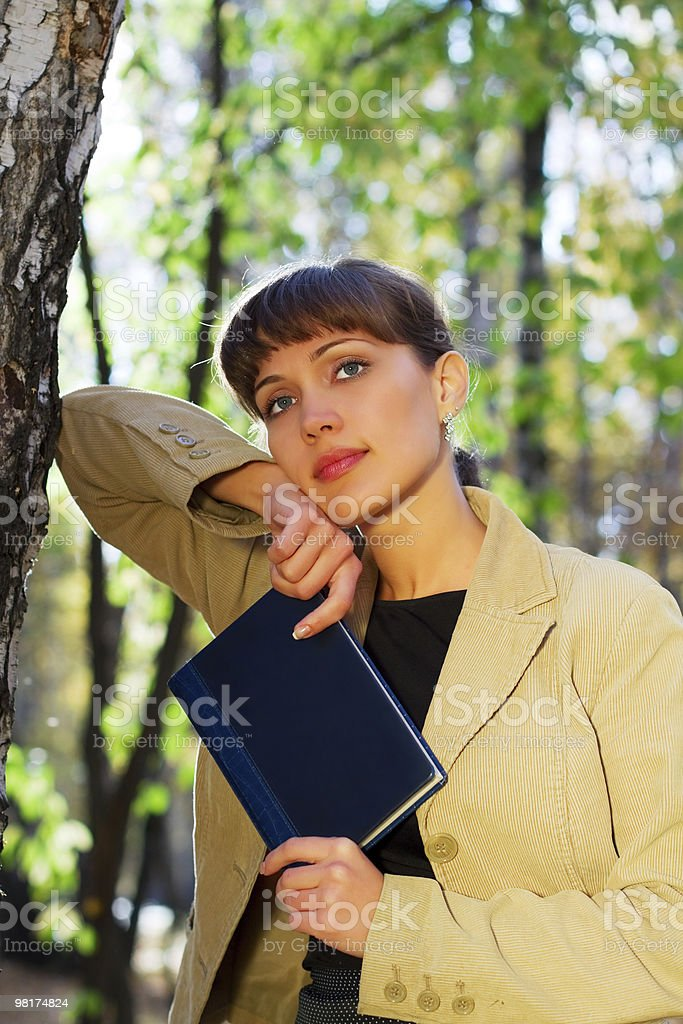 Young businesswoman with a notebook royalty-free stock photo