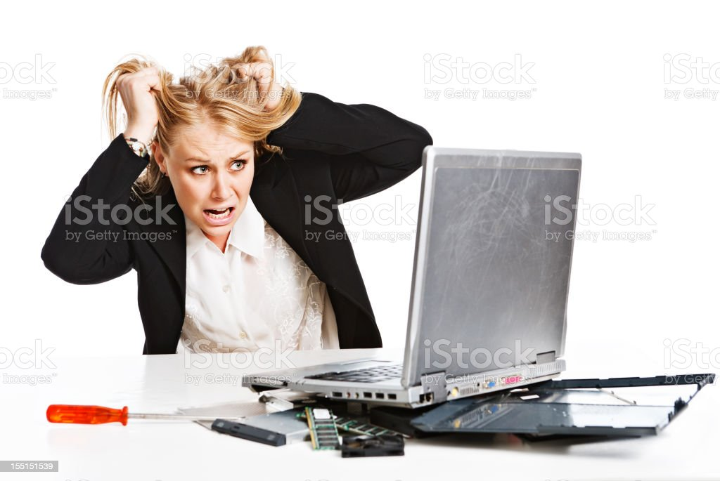 Young businesswoman with broken laptop is frustrated royalty-free stock photo