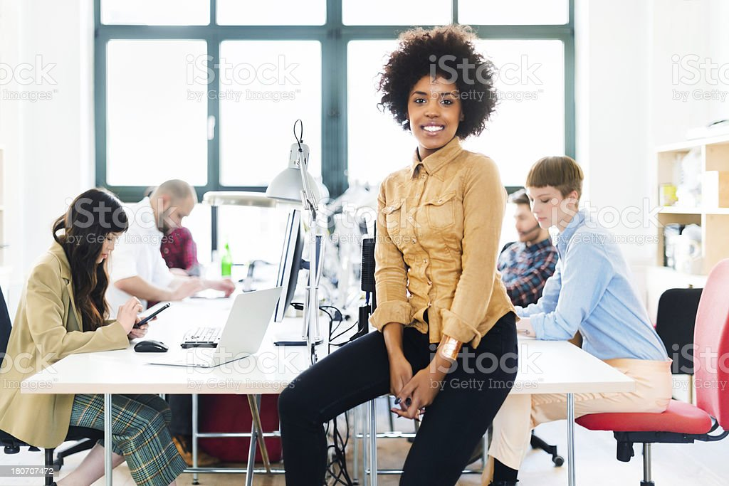 Young Businesswoman With Colleagues In Her Office royalty-free stock photo