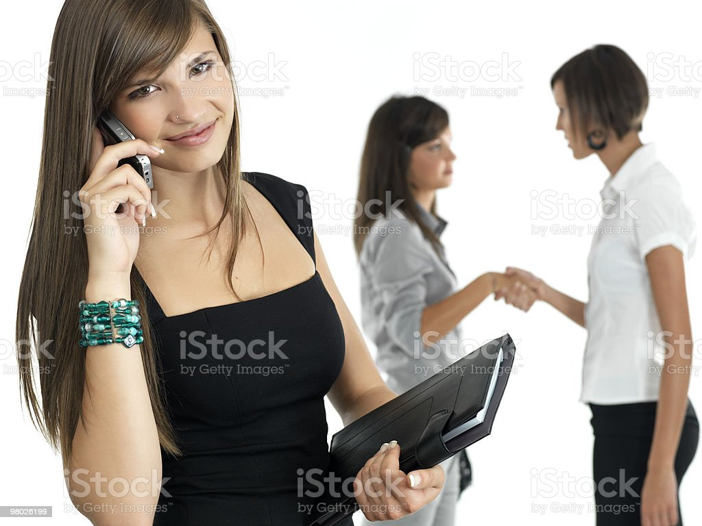 young businesswoman with colleagues in the background royalty-free stock photo