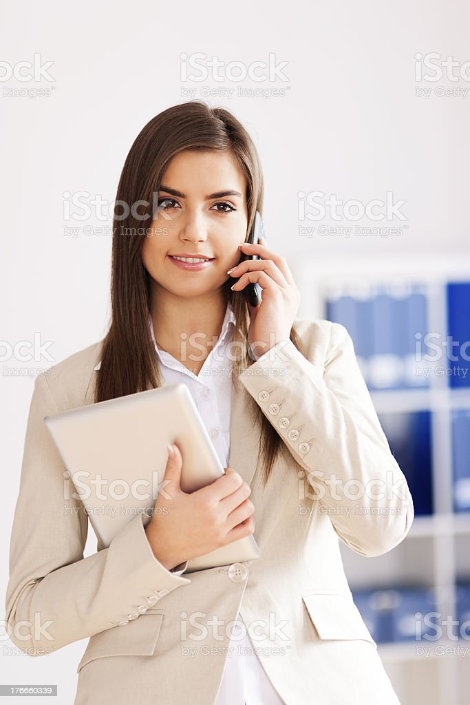 Young businesswoman with digital tablet and mobile phone royalty-free stock photo