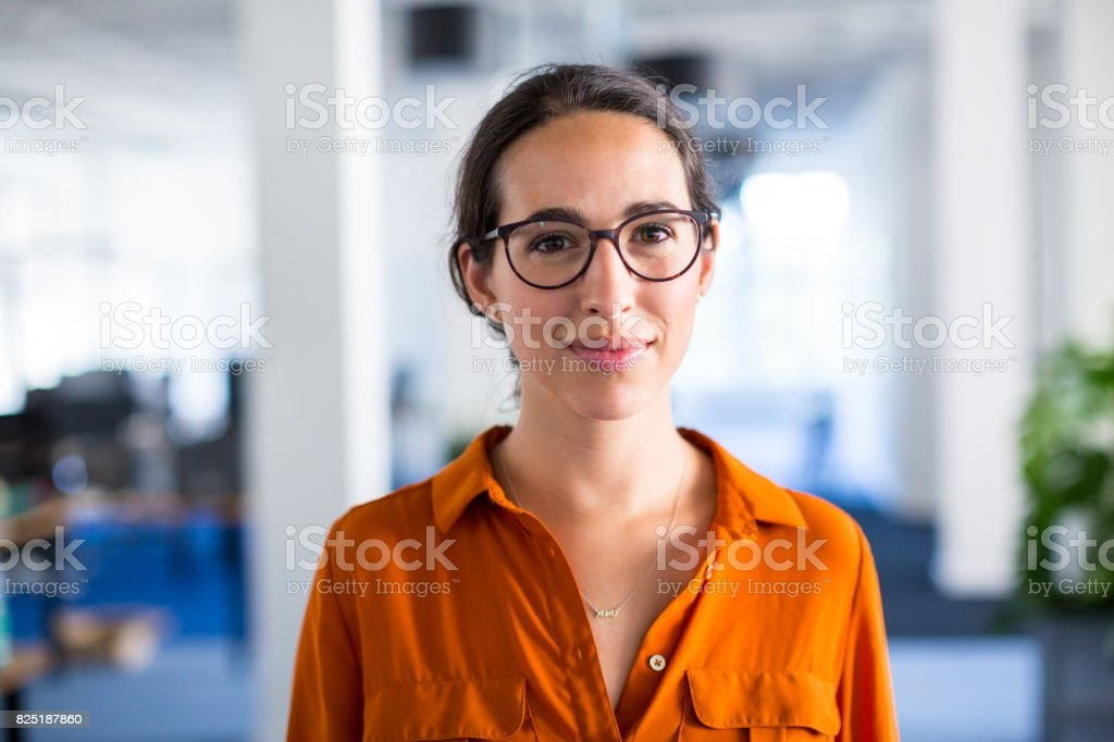 Young businesswoman with eyeglasses in office royalty-free stock photo