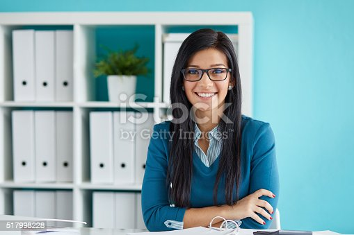 istock Young businesswoman with glasses 517998228