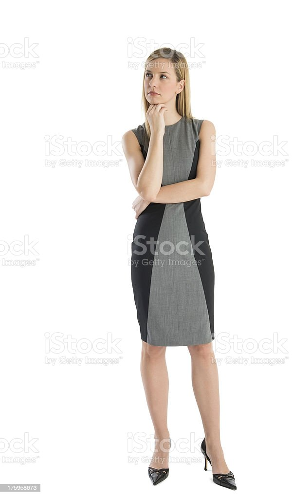 Young Businesswoman With Hand On Chin Looking Away stock photo