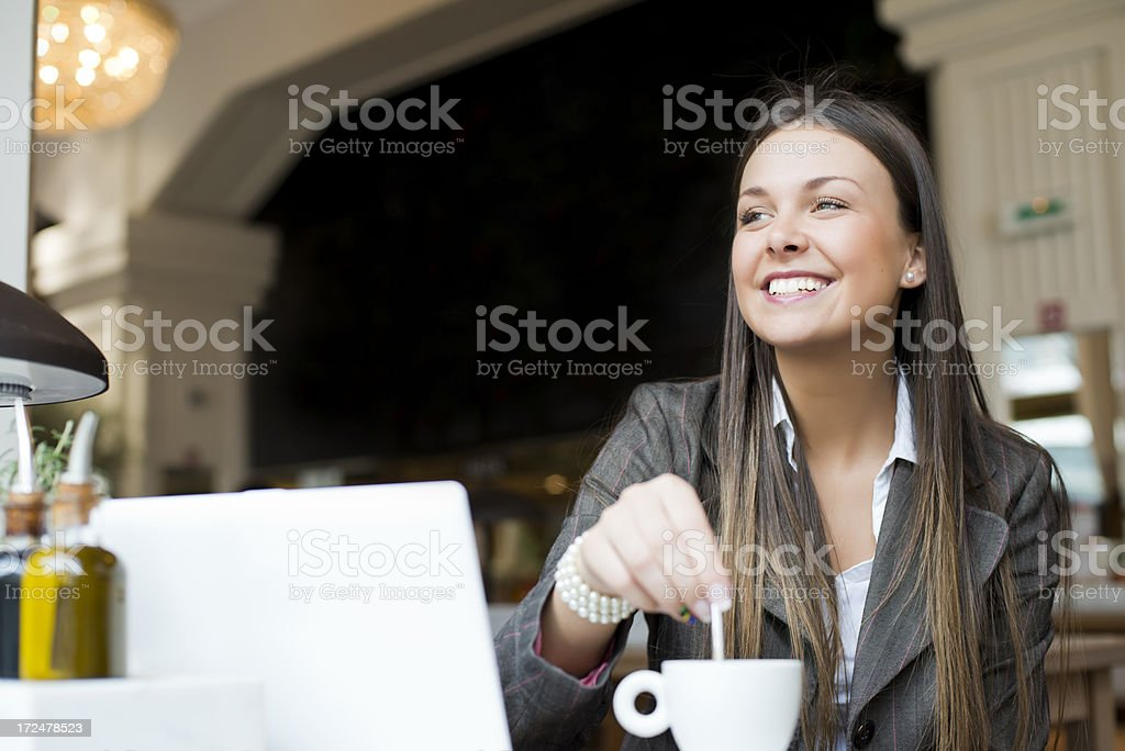 A young businesswoman with laptop in cafe royalty-free stock photo