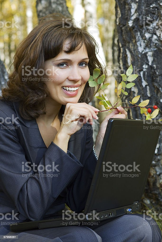 Young businesswoman with laptop royalty free stockfoto