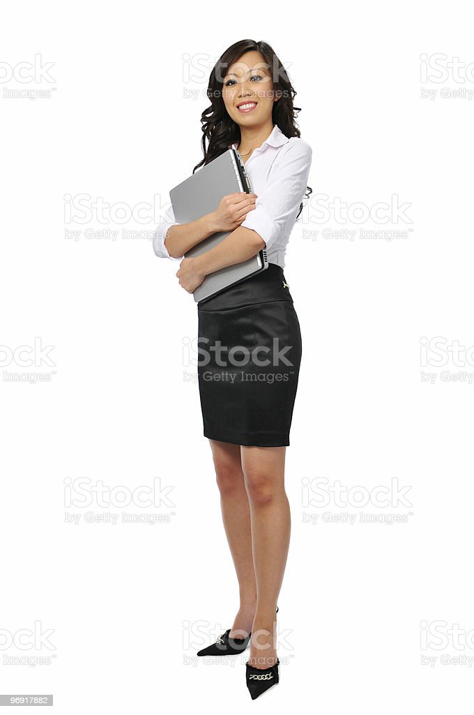 Young businesswoman with laptop standing royalty-free stock photo
