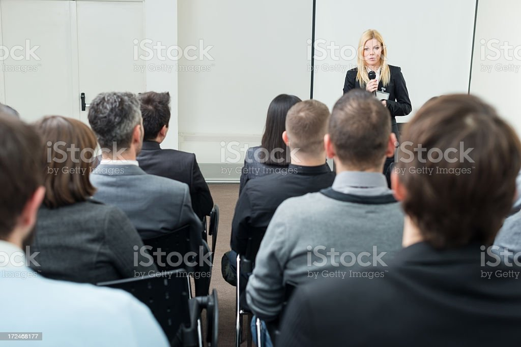 Young businesswoman with microphone royalty-free stock photo