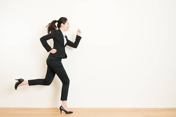 young businesswoman with running on white background - i̇ş kıyafeti stok fotoğraflar ve resimler