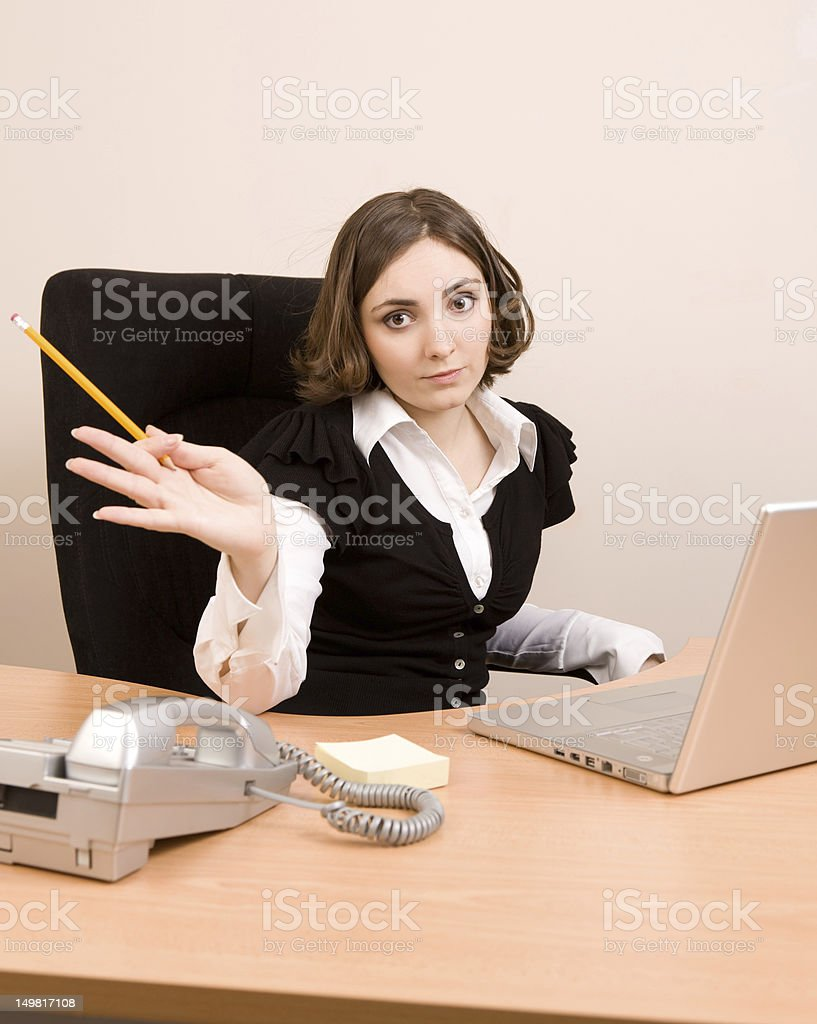 Young businesswoman working at the office stock photo
