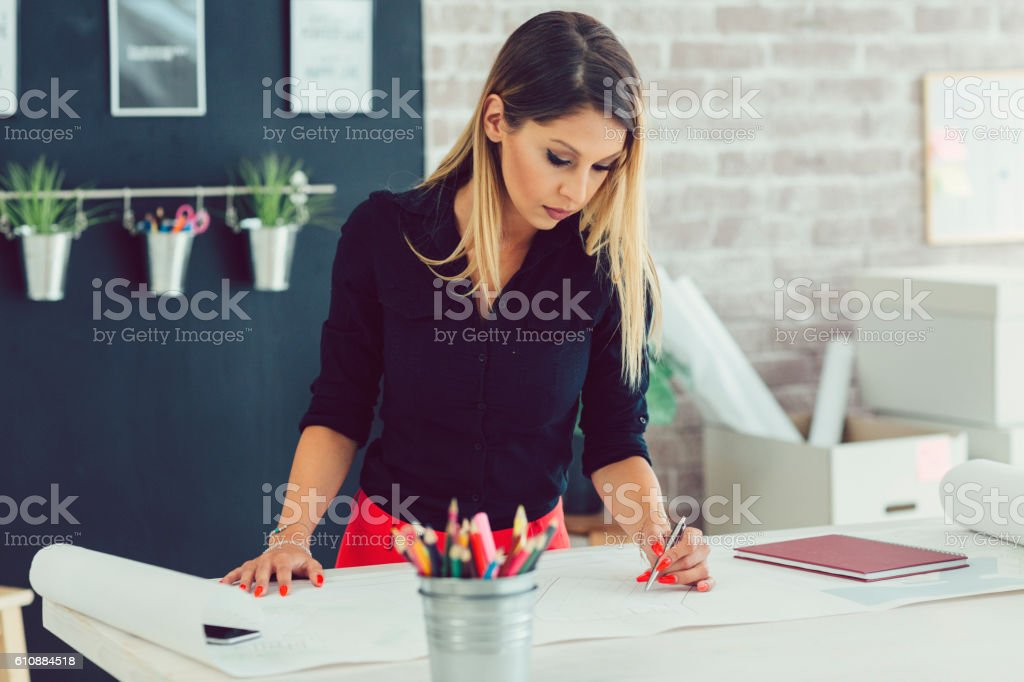 Young Businesswoman Working In Her Office. stock photo