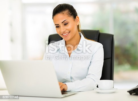 istock young businesswoman working in office 528722145