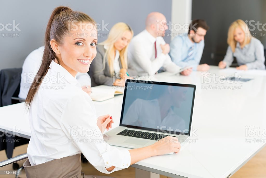 Young businesswoman working on laptop royalty-free stock photo