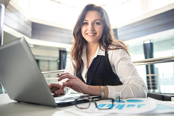 Young businesswoman working on laptop stock photo