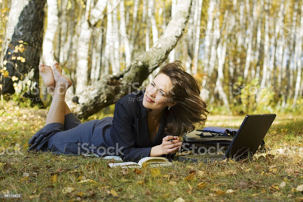Young businesswoman working on nature royalty-free stock photo