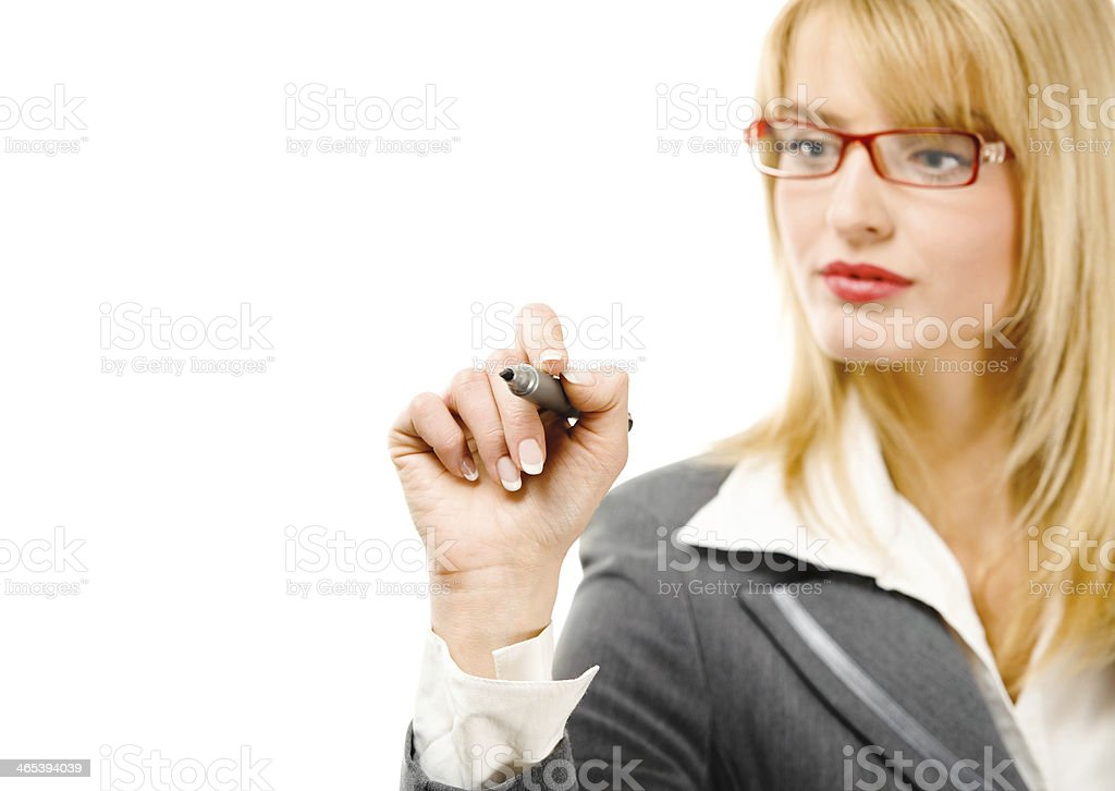 Young businesswoman writing on board stock photo