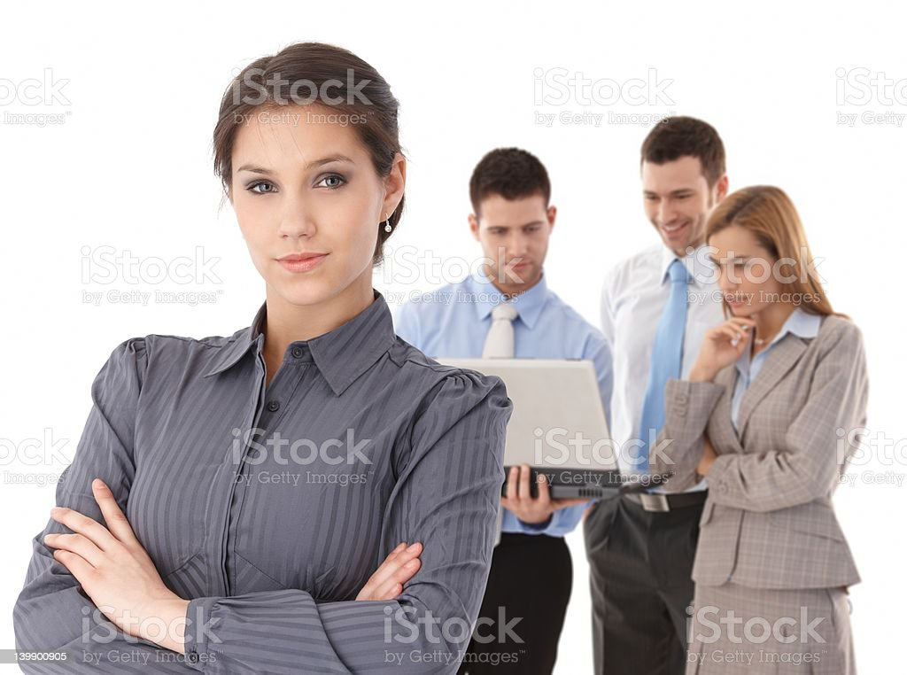 Young businesswomen in front of team royalty-free stock photo