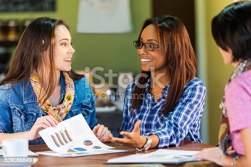 Young businesswomen reveiwing financial documents for small business