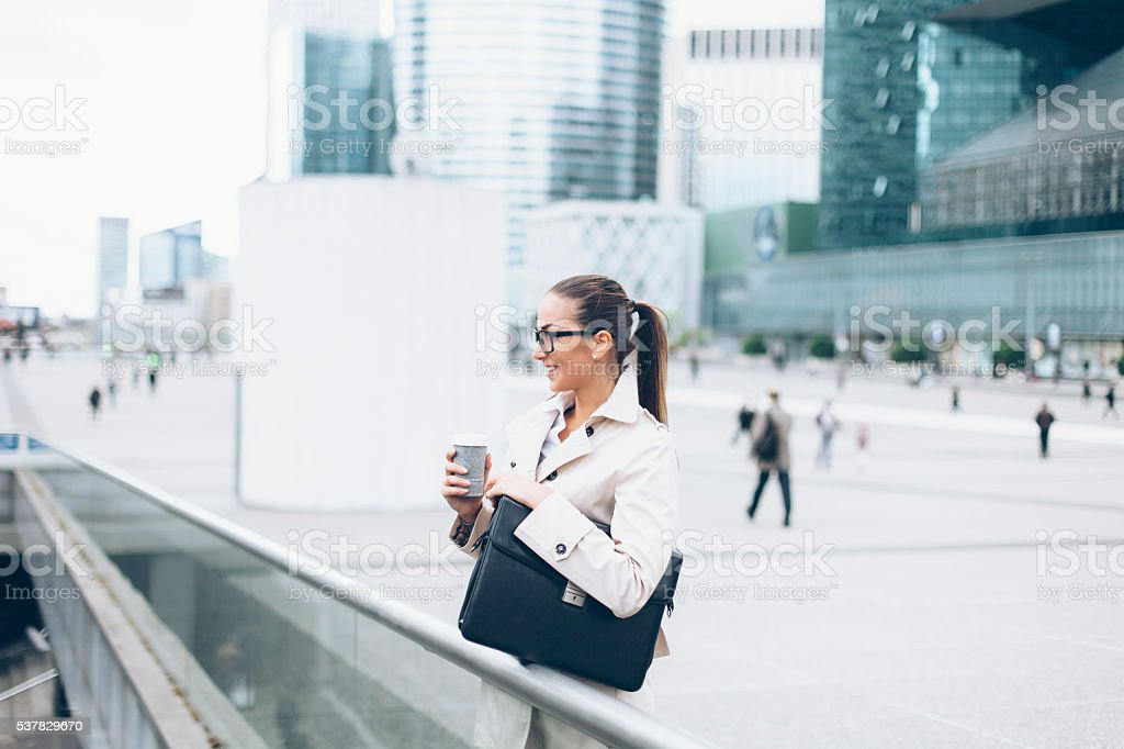 Young bussineswoman drinking coffee outdoor stock photo