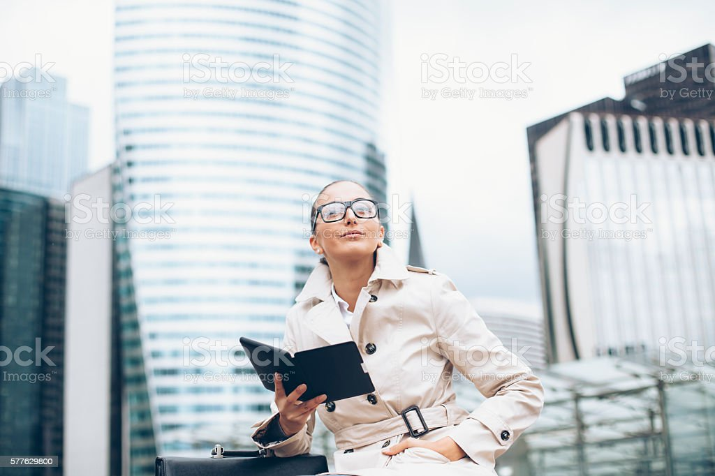 Young bussineswoman sitting and holding digital tablet stock photo