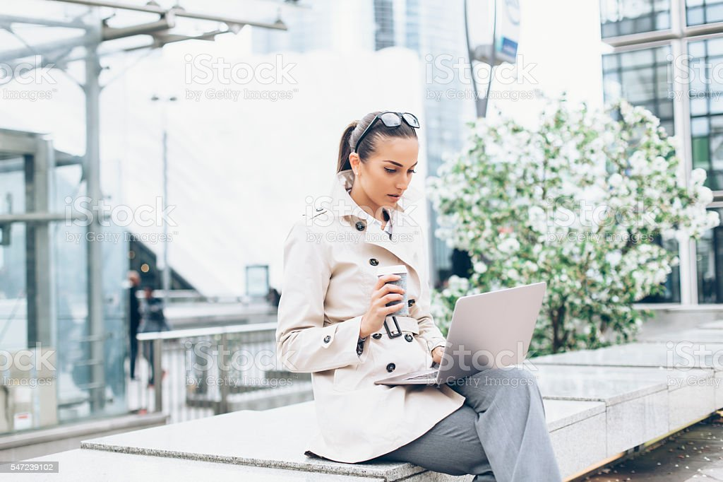 Young bussineswoman sitting and using laptop stock photo