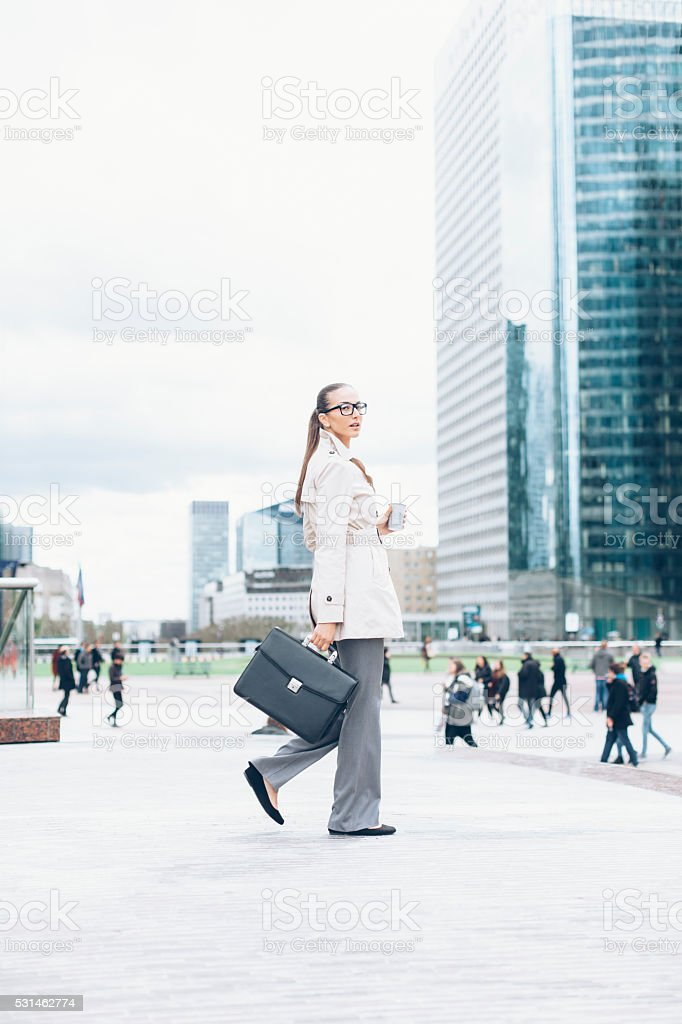Young bussineswoman walking on street stock photo