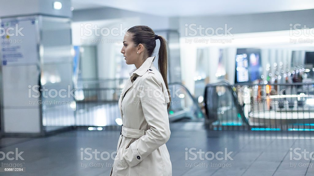 Young bussineswoman walking on subway station stock photo