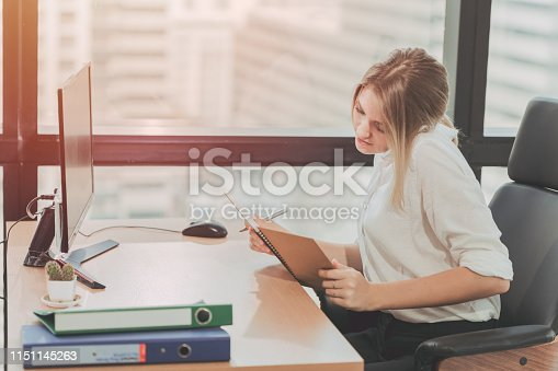 istock Young Busy Businessgirl Working Busy in Office,Receptionist and Personal Assistant Taking Note vintage color tone 1151145263