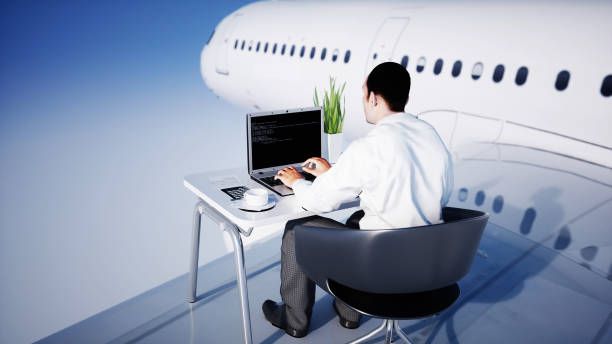Young busy businessman working on the flying airplane. African male looking into the screen of the laptop on the desk. Creative workspace concept. 3d rendering. stock photo