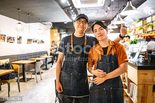 Portrait of two young Asian people working in a coffee shop
