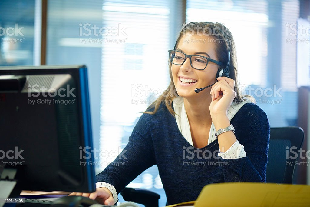 young call centre rep stock photo