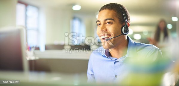 istock young call centre worker chatting. 843763282