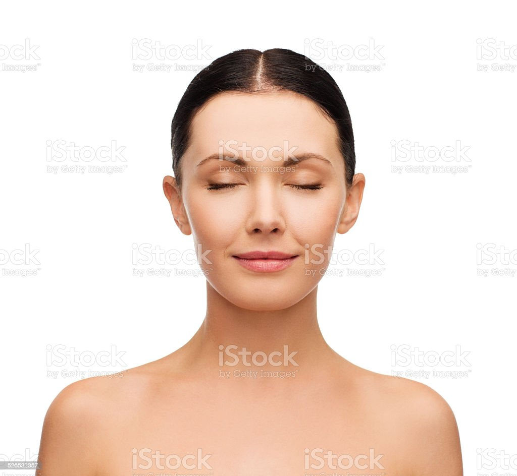 young calm woman face with closed eyes stock photo