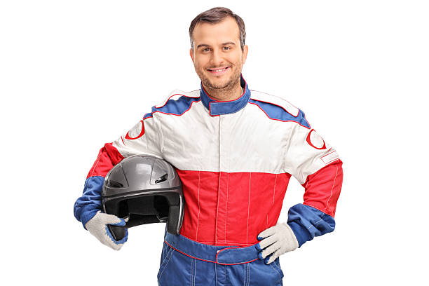 young car racer holding a gray helmet - sports uniform stock photos and pictures