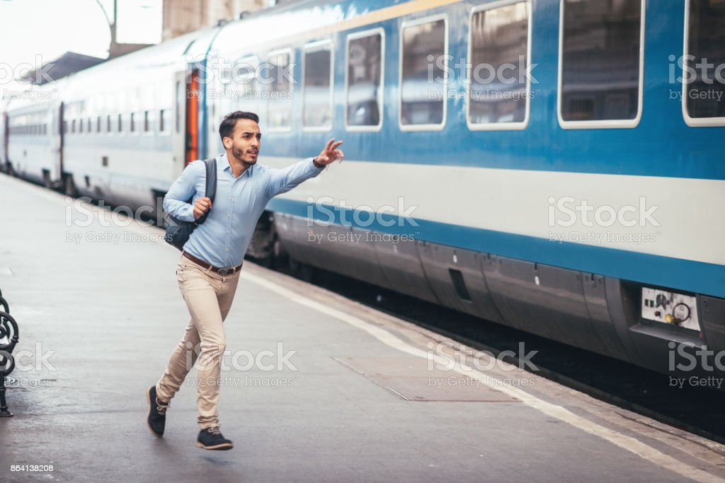 Young career builder is late for the morning train royalty-free stock photo