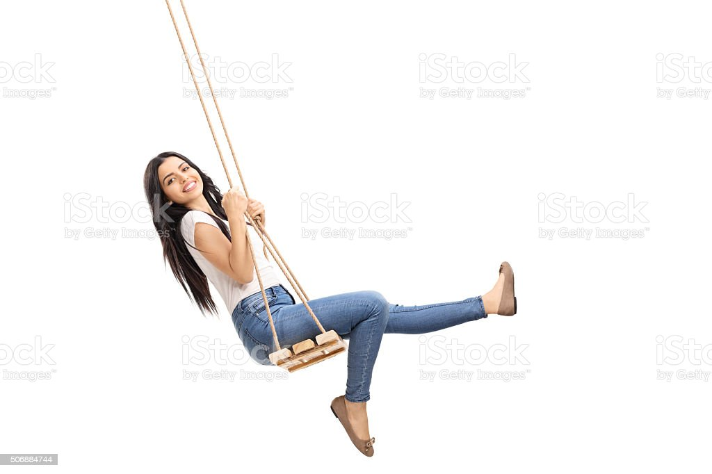 Young carefree girl swinging on a swing stock photo