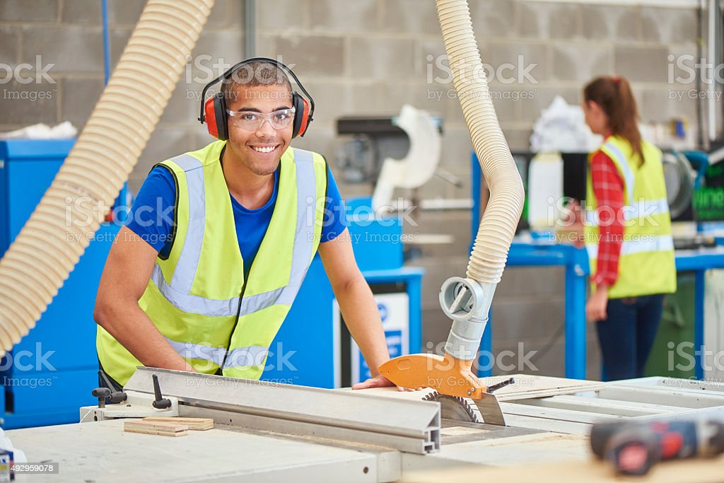 young carpenter in the woodshop stock photo