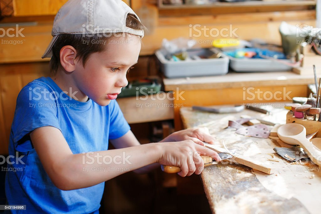 young carpenter working in a workshop stock photo