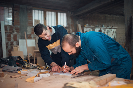 Young Carpenters Working In The Workshop Stock Photo