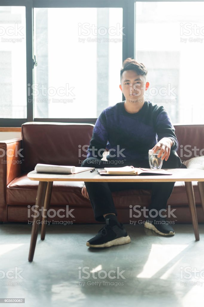 young casual businessman working on sofa stock photo