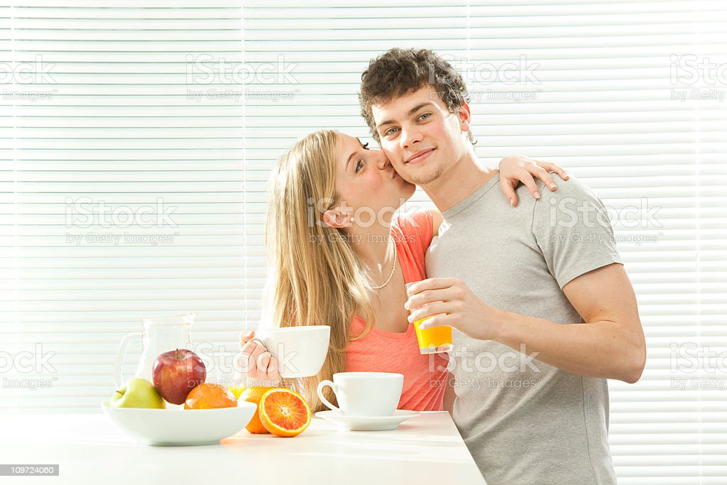 Young casual couple has breakfast with fruit juice royalty-free stock photo