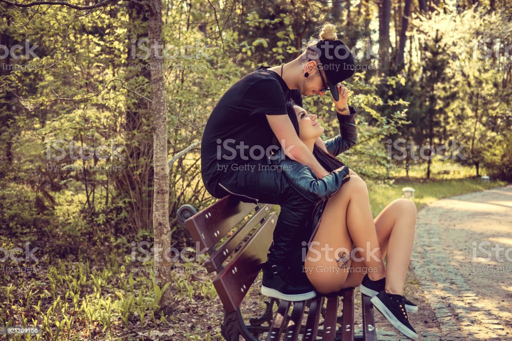 Young casual couple relaxing on a bech. stock photo