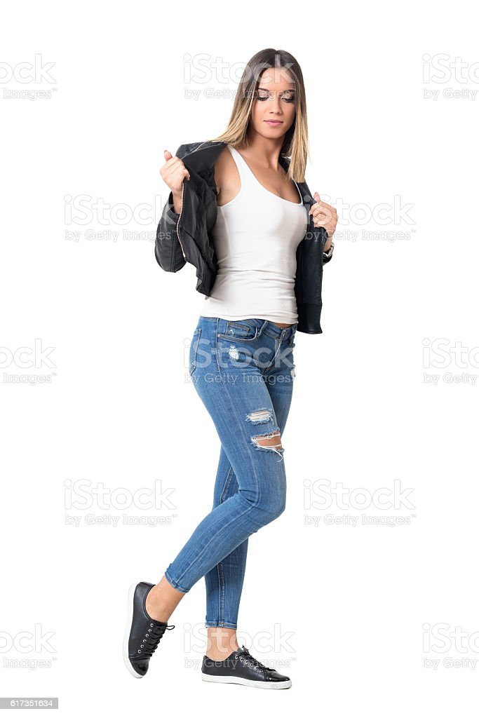 Young Casual Girl With Ombre Hairstyle Taking Off Leather Jacket