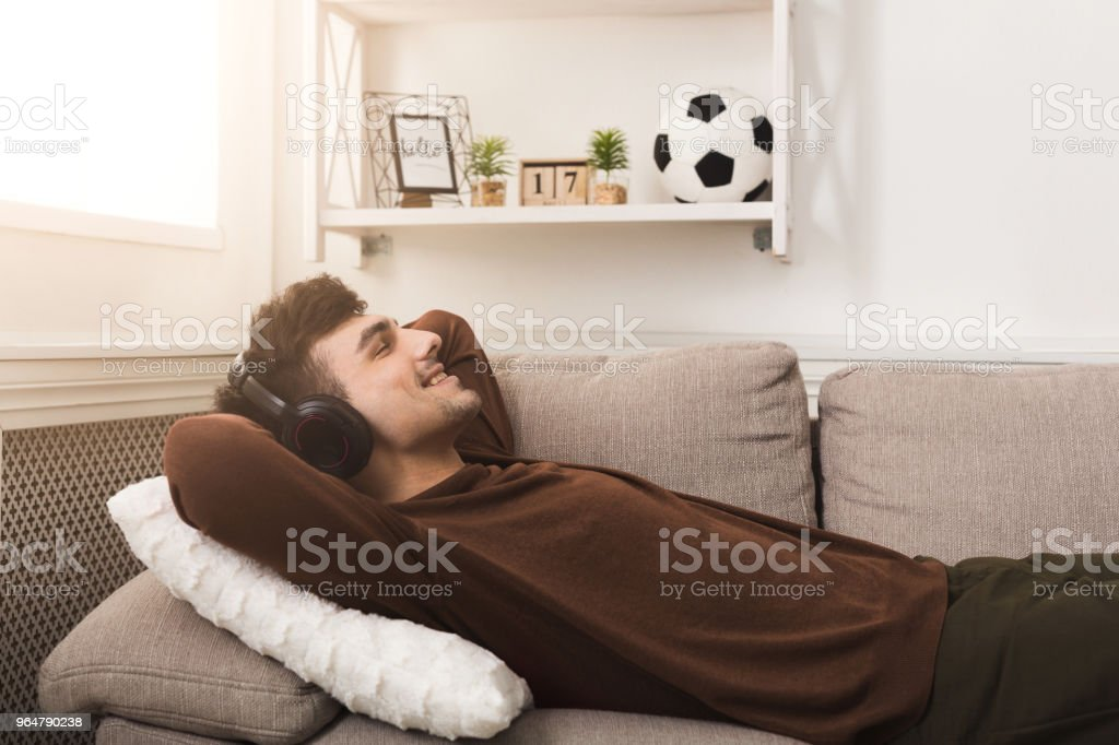 Young casual man in headphones at home royalty-free stock photo