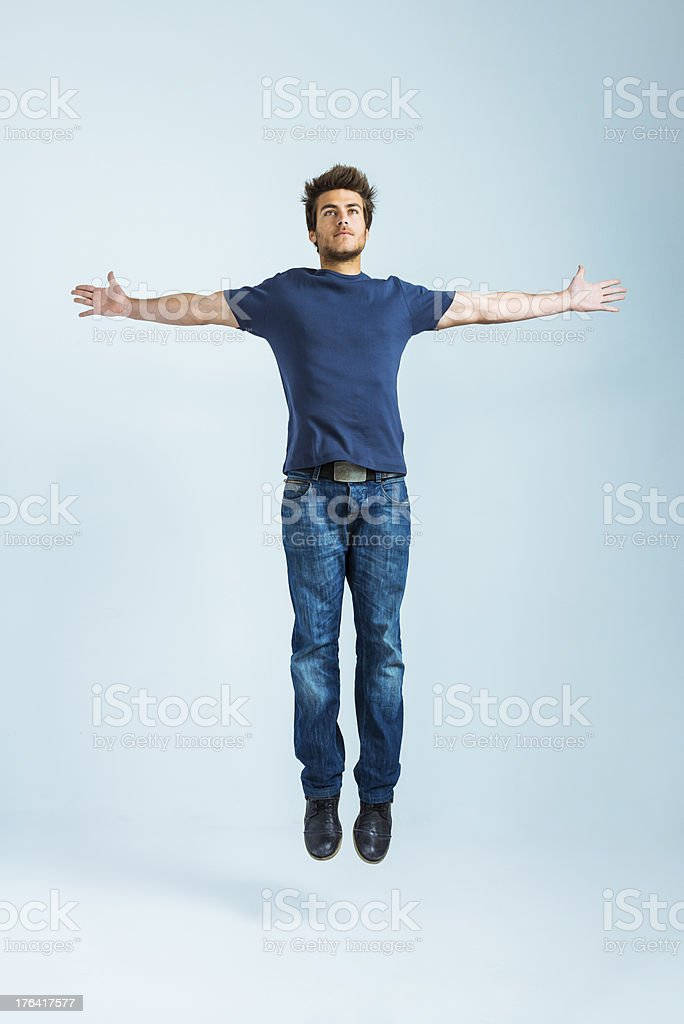 Young casual man jumping stock photo