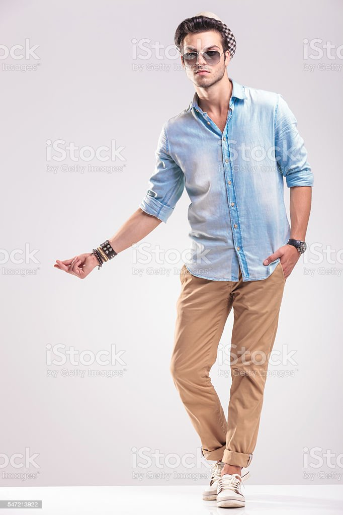Young casual man snapping his fingers stock photo