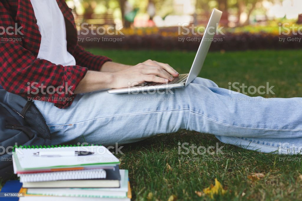 Young casual man with laptop outdoors stock photo